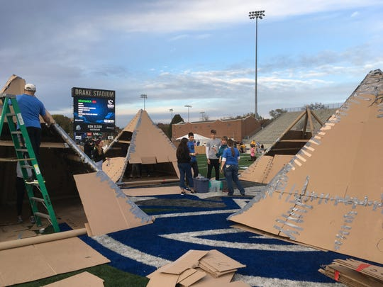 International students in the FLEX and YES programs built pyramid structures from cardboard to camp in.
