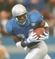 Detroit Lions receiver Herman Moore catches a touchdown against the Buffalo Bills at The Silverdome, Nov. 24, 1994.