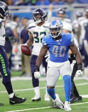 Jarrad Davis celebrates a tackle against the Seahawks earlier this season.