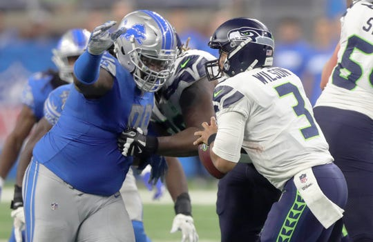Detroit Lions defensive tackle Damon Harrison Sr. sacks Seattle Seahawks quarterback Russell Wilson during the fourth quarter Sunday, October 28, 2018 at Ford Field in Detroit.