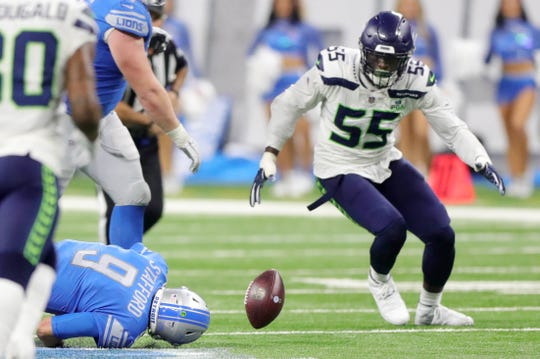 Detroit Lions quarterback Matthew Stafford fumbles the ball trying to scramble as Seattle Seahawks defensive end Frank Clark tries to recover the ball during the fourth quarter Sunday, October 28, 2018 at Ford Field in Detroit.