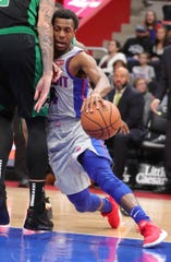 Detroit Pistons guard Ish Smith drives against Boston Celtics forward Daniel Theis Saturday, October 27, 2018 at Little Caesars Arena in Detroit, Mich.