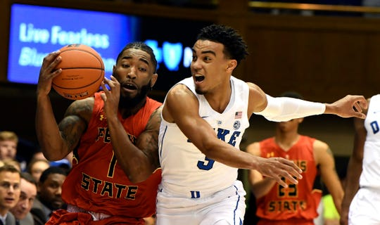 Duke's Tre Jones guard (3) challenges Ferris State's DeShaun Thrower (1) in the first half of an NCAA college basketball exhibition game, Saturday, Oct. 27, 2018, in Durham, N.C.