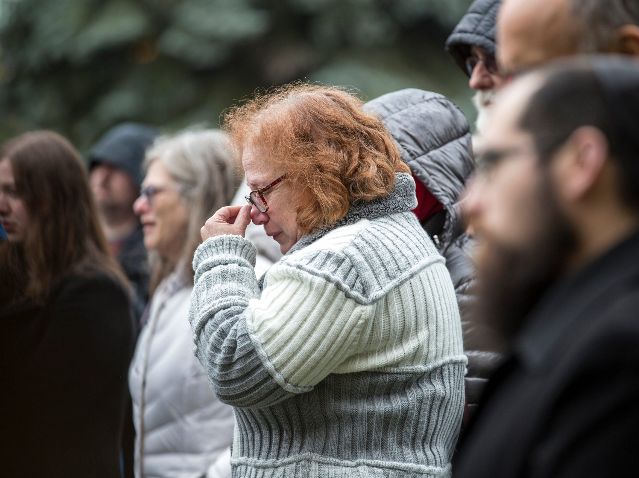 Mourners gather at Jewish Ferndale during a vigil, in honor of 11 people who were killed during a mass shooting in Pittsburgh, on Sunday, Oct. 28, 2018.