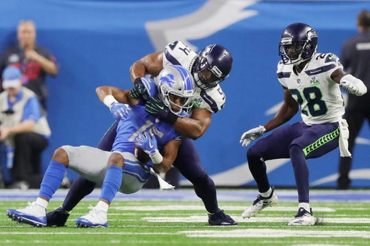 Detroit Lions receiver Golden Tate is tackled by Seattle Seahawks linebacker Bobby Wagner during the third quarter Sunday, October 28, 2018 at Ford Field in Detroit.