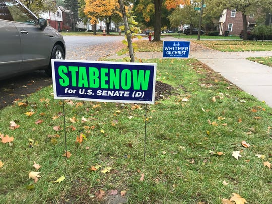 Yard signs in Detroit's historic Rosedale Park neighborhood on Oct. 28, 2018 before the Nov. 6 midterm elections.