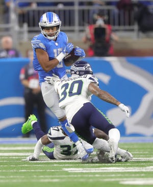 Detroit Lions receiver Golden Tate makes a catch against Seattle Seahawks defensive backs Tre Flowers and Bradley McDougald, Sunday, Oct. 28, 2018 at Ford Field in Detroit.