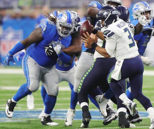 Damon Harrison sacks Russell Wilson during the fourth quarter.