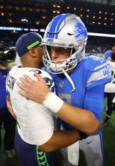 Seattle Seahawks quarterback Russell Wilson greets Detroit Lions quarterback Matthew Stafford after the Seahawks beat the Lions 28-14 at Ford Field on Oct. 28, 2018 in Detroit.