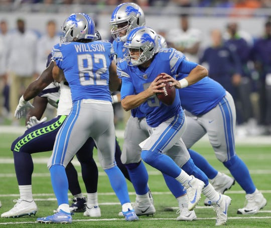 Matthew Stafford moves in the pocket against the Seahawks during the third quarter Sunday.