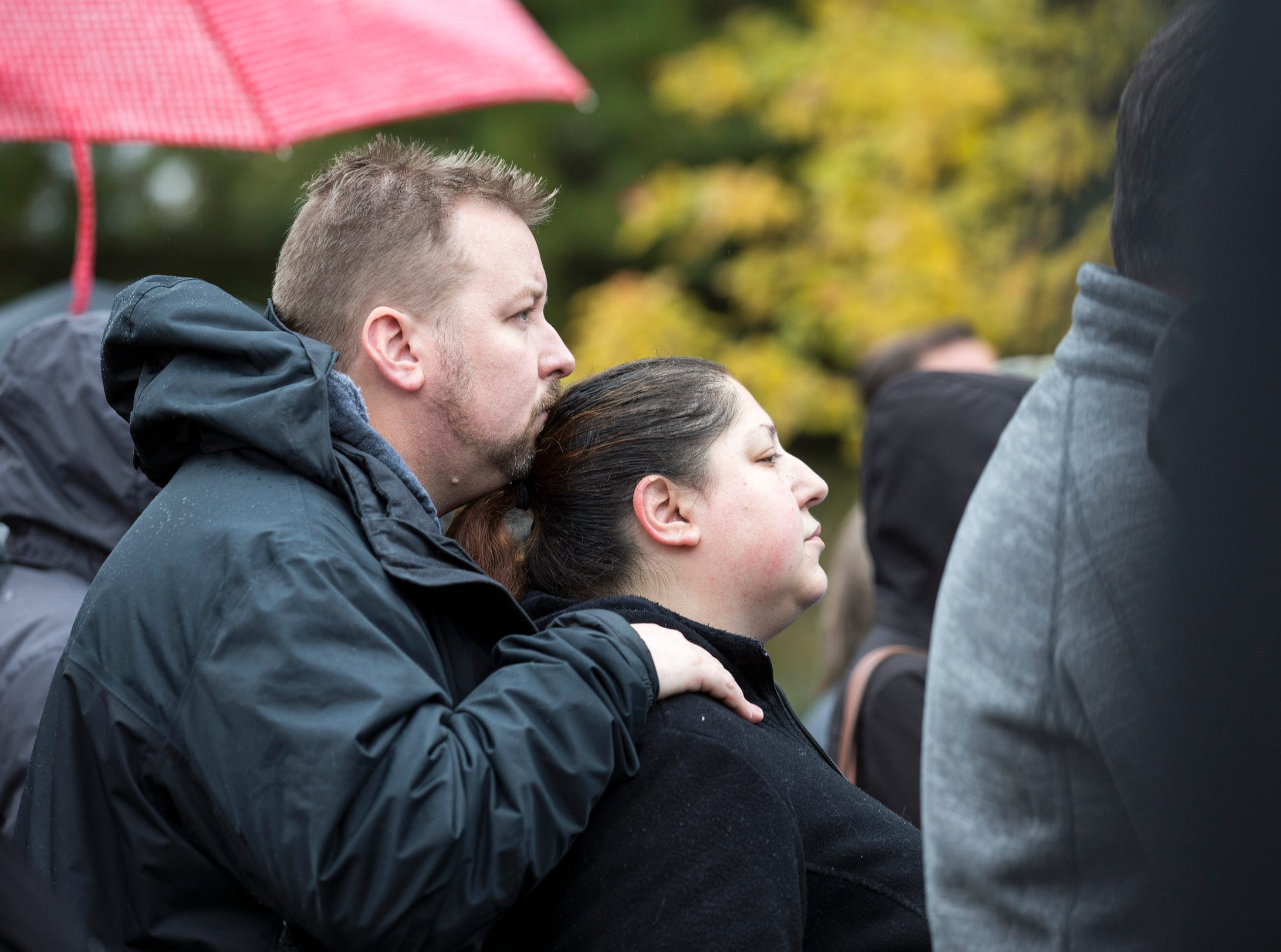 From left, Ross Sandelius, 37 and his wife Julie Bagley, 38 of Ferndale, comfort each other during a vigil, in honor of 11 people who were killed during a mass shooting in Pittsburgh, at Jewish Ferndale in Ferndale, Mich., Sunday, Oct. 28, 2018.