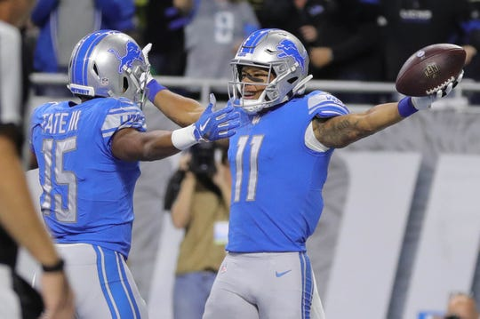 Detroit Lions receivers Marvin Jones Jr. (11) and Golden Tate celebrate Jones' touchdown during the first half against the Seattle Seahawks on Sunday, October 28, 2018 at Ford Field in Detroit.