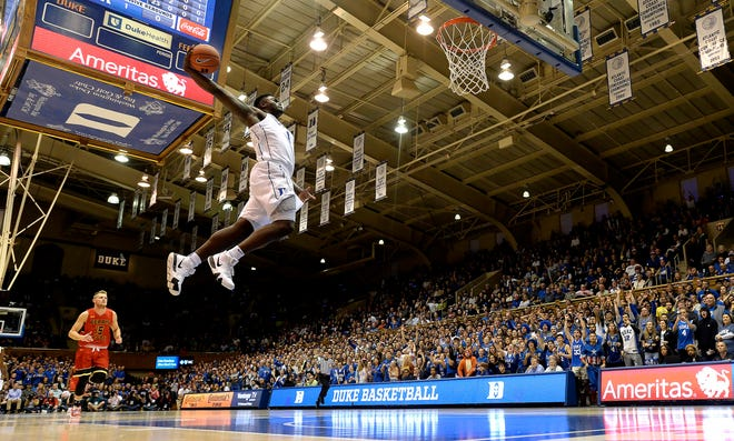 Duke's Zion Williamson  (1) goes in for a breakaway dunk as Ferris State's Greg Williams (15) looks on in the first half of an NCAA college basketball exhibition game, Saturday, Oct. 27, 2018, in Durham, N.C.