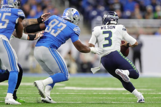 Detroit Lions' Da'Shawn Hand pressures Seattle Seahawks quarterback Russell Wilson during the first half Sunday on October 28, 2018 at Ford Field in Detroit.