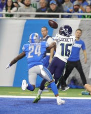 Nevin Lawson gives up a touchdown to Seahawks receiver Tyler Lockett during the first half.