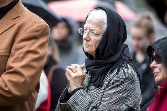 Ann Heler, 76 of Ferndale, stands with her hands clasped in prayer during a vigil, in honor of 11 people who were killed during a mass shooting in Pittsburgh, at Jewish Ferndale in Ferndale, Mich., Sunday, Oct. 28, 2018.