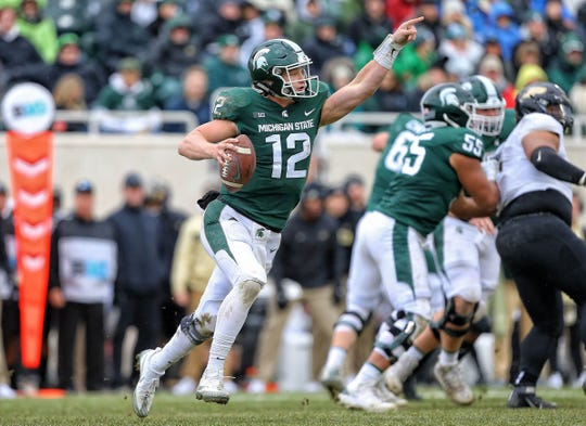 Michigan State quarterback Rocky Lombardi directs receivers during the second half against Purdue on Oct. 27.