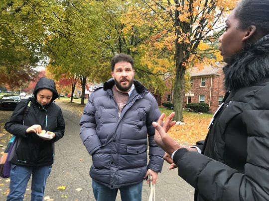 (Left) Sosie and Joshua Berg working with Color of Change PAC's canvas organizer Jacinda Cason in Detroit's Rosedale Park neighborhood on Oct. 28, 2018.