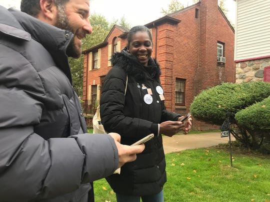 (Left) Joshua Berg, a volunteer, and the Color of Change PAC canvas director Jacinda Cason in Detroit's Rosedale Park neighborhood on Oct. 28, 2018.