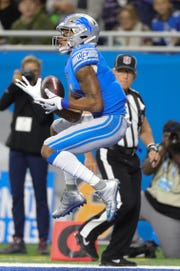 Marvin Jones Jr. catches a touchdown pass during the first half against the Seahawks.
