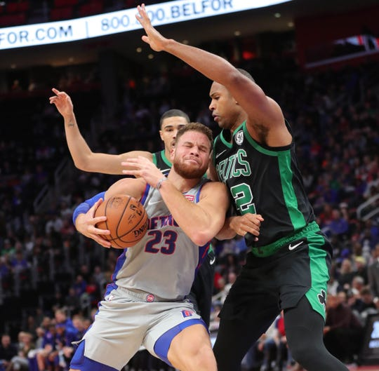 Blake Griffin drives against Celtics center Al Horford on Saturday at LCA.