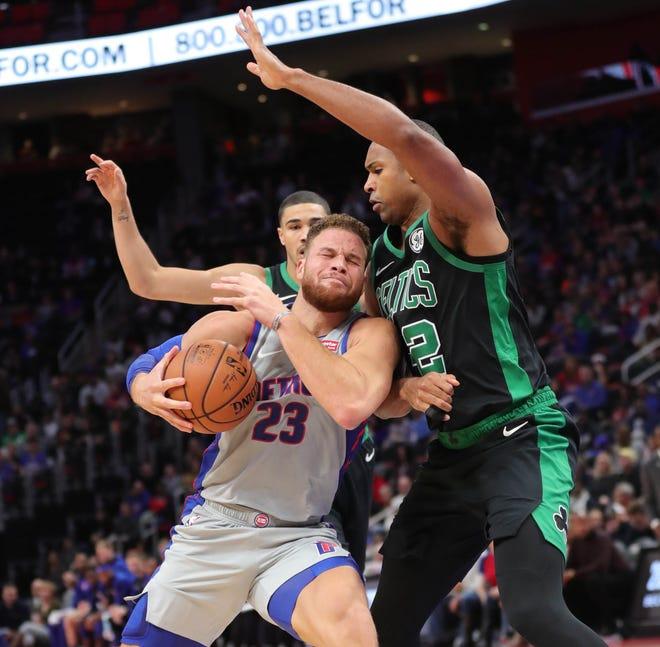 Detroit Pistons forward Blake Griffin drives against Boston Celtics center Al Horford, Oct.27, 2018 at Little Caesars Arena in Detroit.