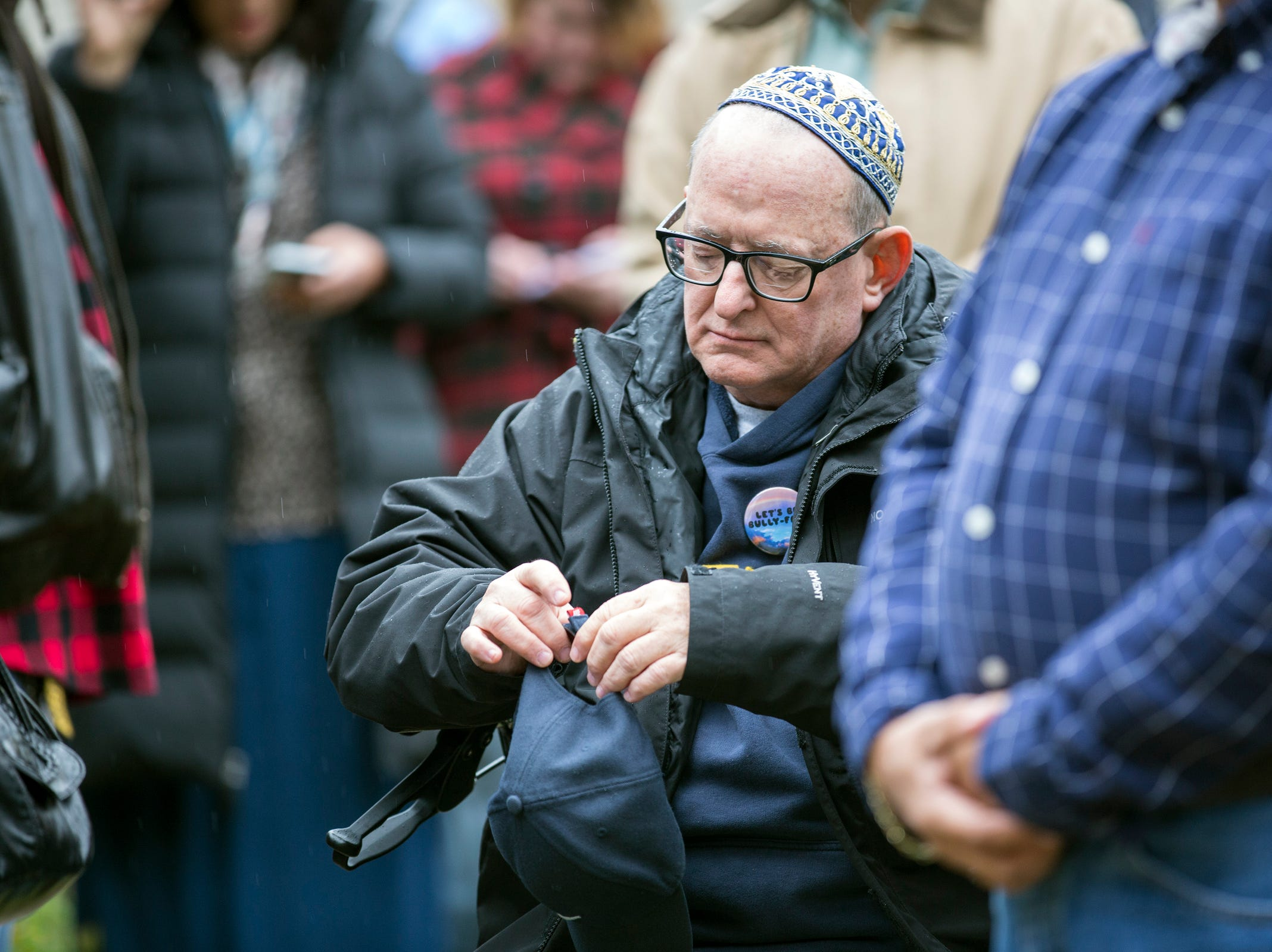David Crandall of Royal Oak, gathers with others during a vigil, in honor of 11 people who were killed during a mass shooting in Pittsburgh, at Jewish Ferndale in Ferndale, Mich., Sunday, Oct. 28, 2018.