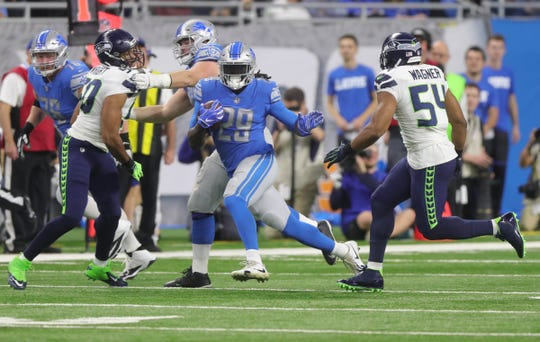 Detroit Lions running back LeGarrette Blount runs the ball against the Seattle Seahawks during the first half Sunday, October 28, 2018 at Ford Field in Detroit.