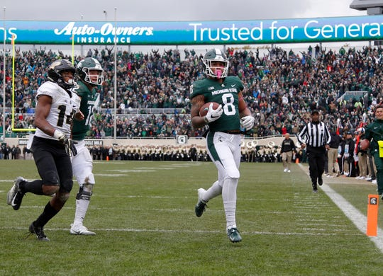 Michigan State's Jalen Nailor scores a touchdown against Purdue, with the help of quarterback Rocky Lombardi, during the fourth quarter Saturday, Oct. 27, 2018, in East Lansing.
