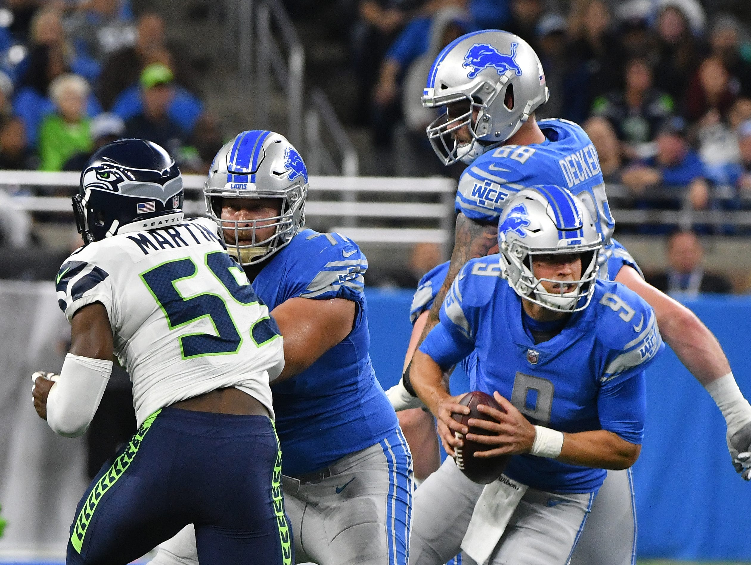 Lions quarterback Matthew Stafford scrambles out of pressure and throws a touchdown pass to Marvin Jones Jr. in the first quarter.