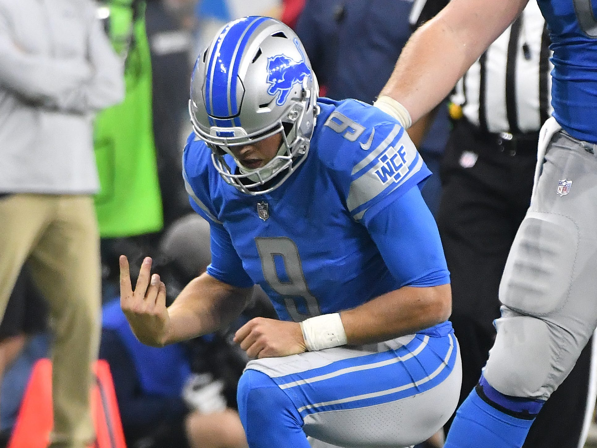 Lions quarterback Matthew Stafford shakes out his throwing hand after being taken down, with Seattle picking up a roughing the passer penalty, in the fourth quarter.
