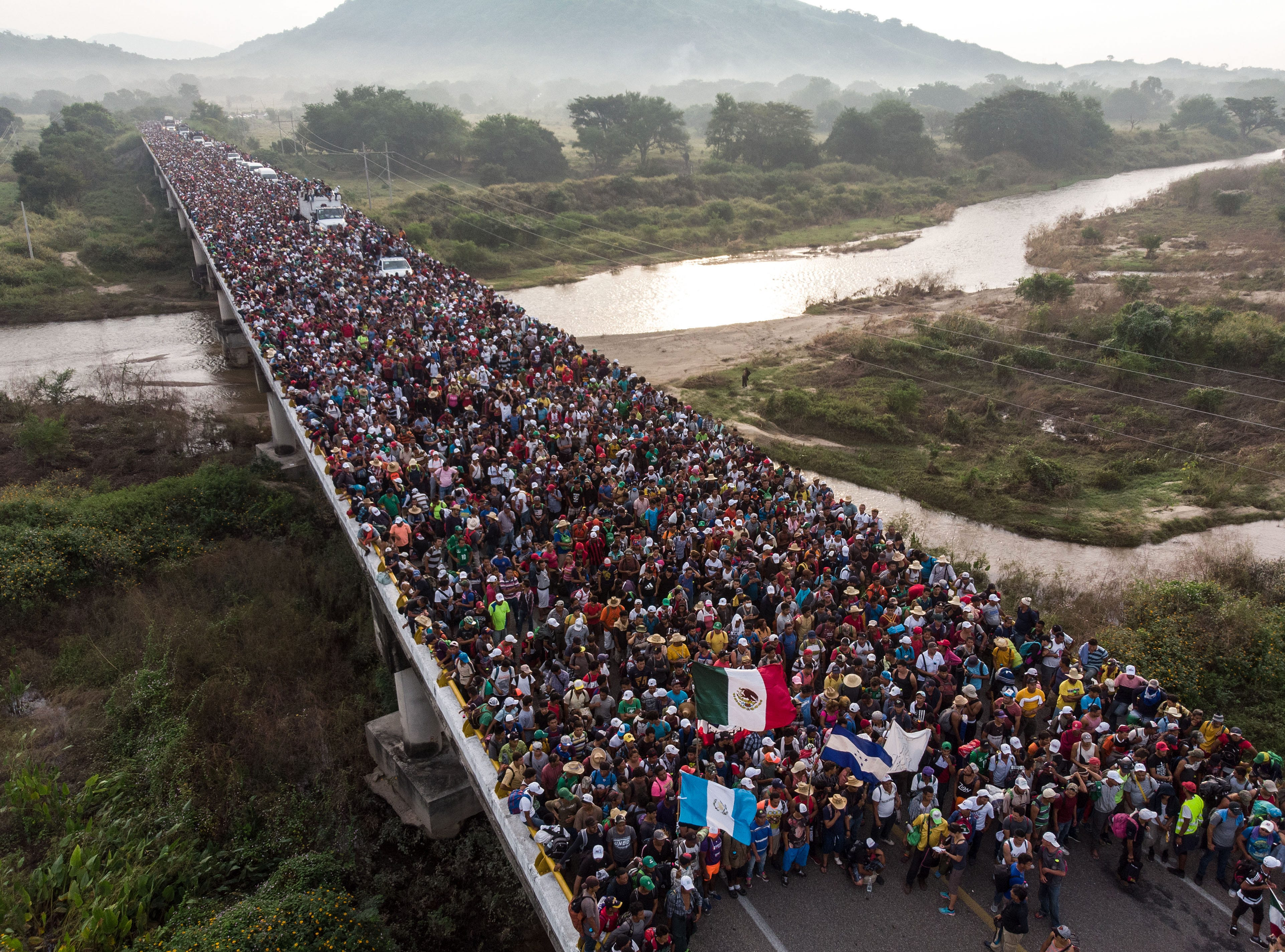 The U.S.-bound caravan of Honduran migrants leaves Arriaga en route to San Pedro Tapanatepec, in southern Mexico on Saturday, Oct. 27, 2018. Mexico on Friday announced it will offer Central American migrants medical care, education for their children and access to temporary jobs as long as they stay in two southern states.