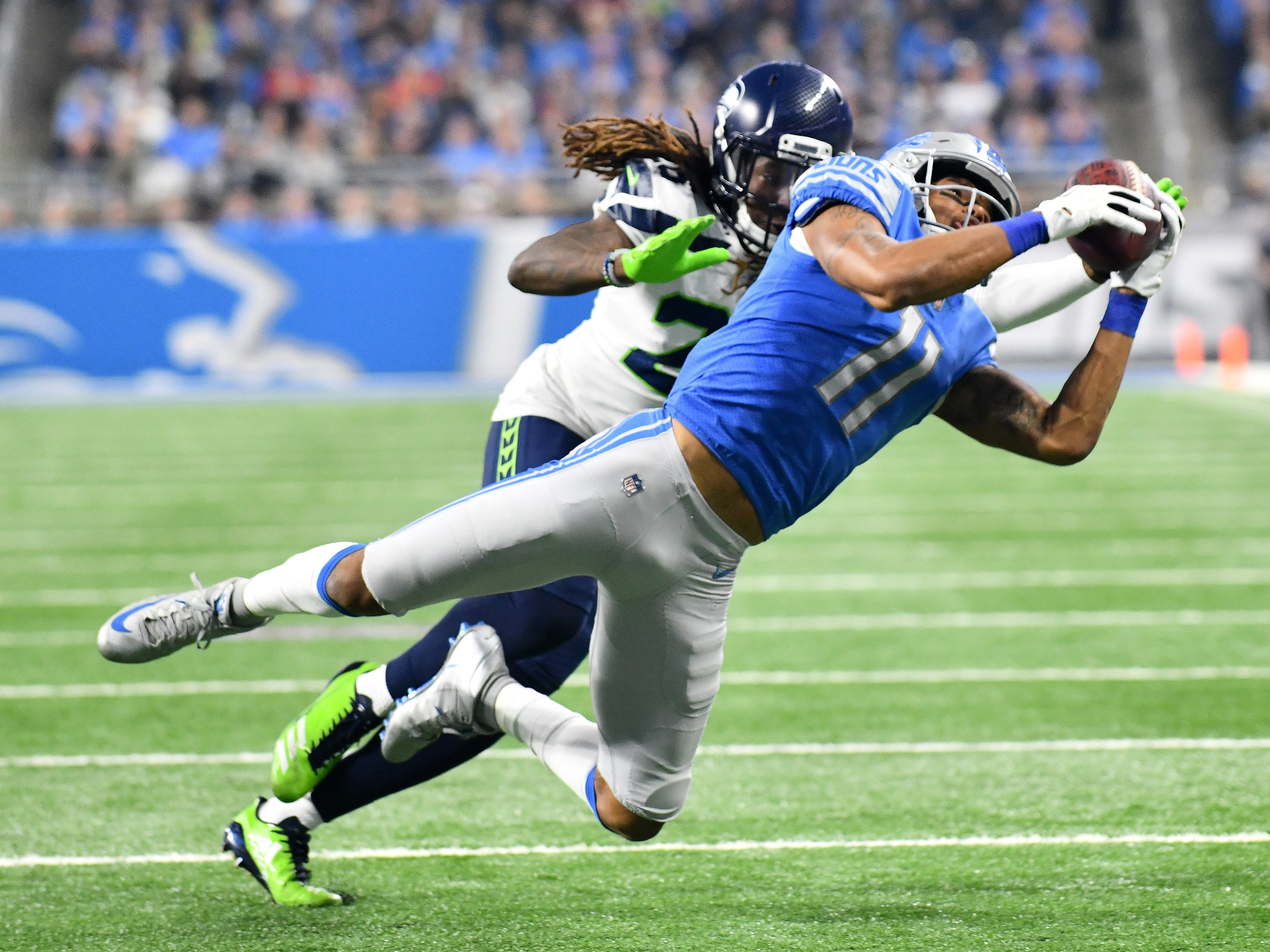 Lions wide receiver Marvin Jones Jr. pulls in a tough reception in front of Seahawks' Justin Coleman in the third quarter.