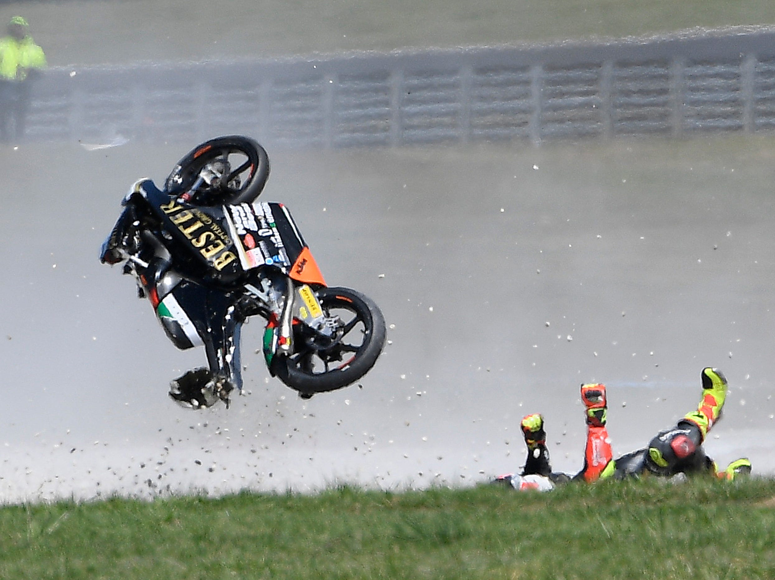 Bester Capital Dubai rider Marcos Ramirez of Spain crashes during the Moto3 race of the Australian Motorcycle Grand Prix at Phillip Island, Sunday, Oct. 28, 2018.