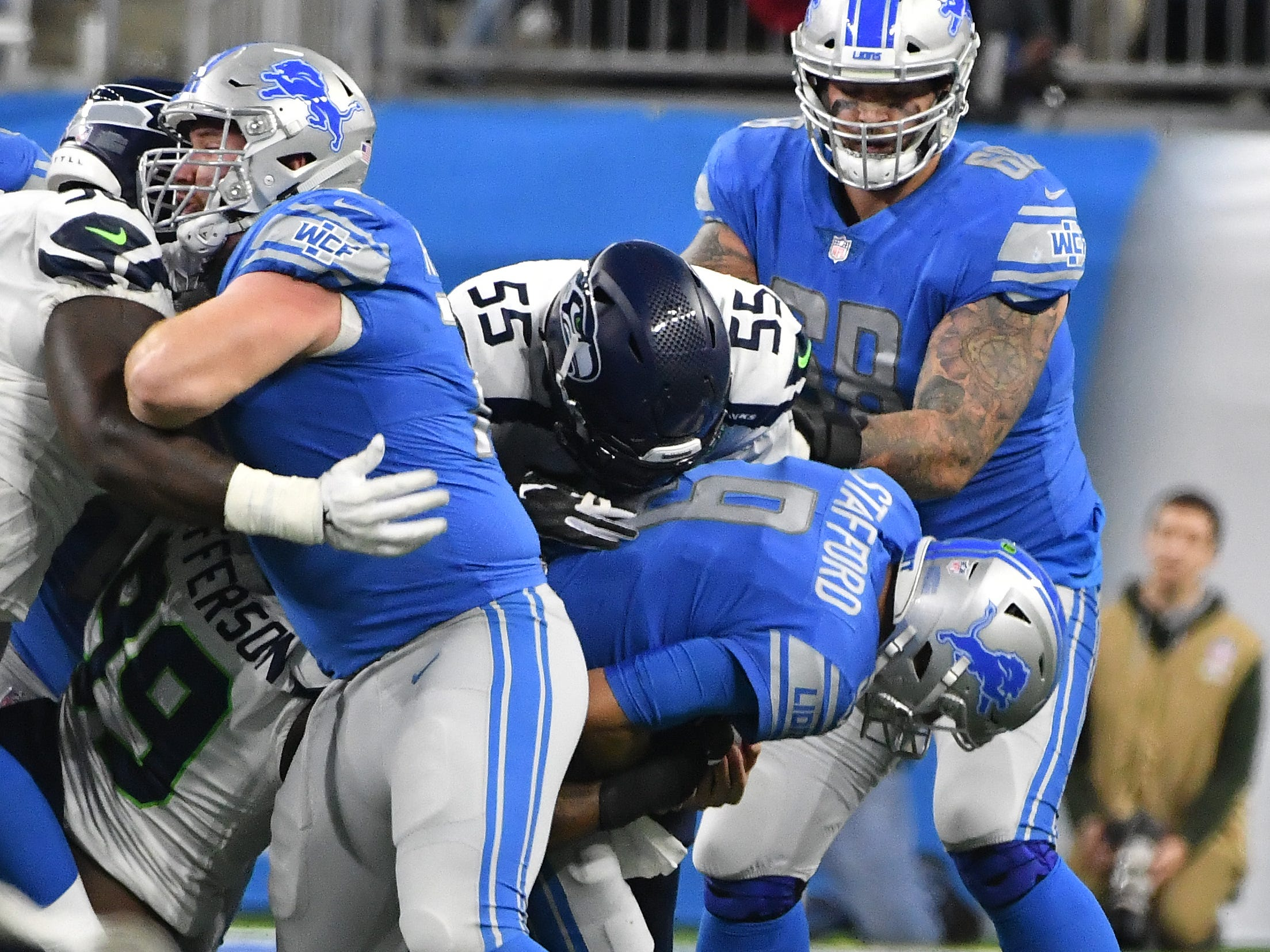 Lions quarterback Matthew Stafford is sacked by Seahawks' Frank Clark in the second quarter.