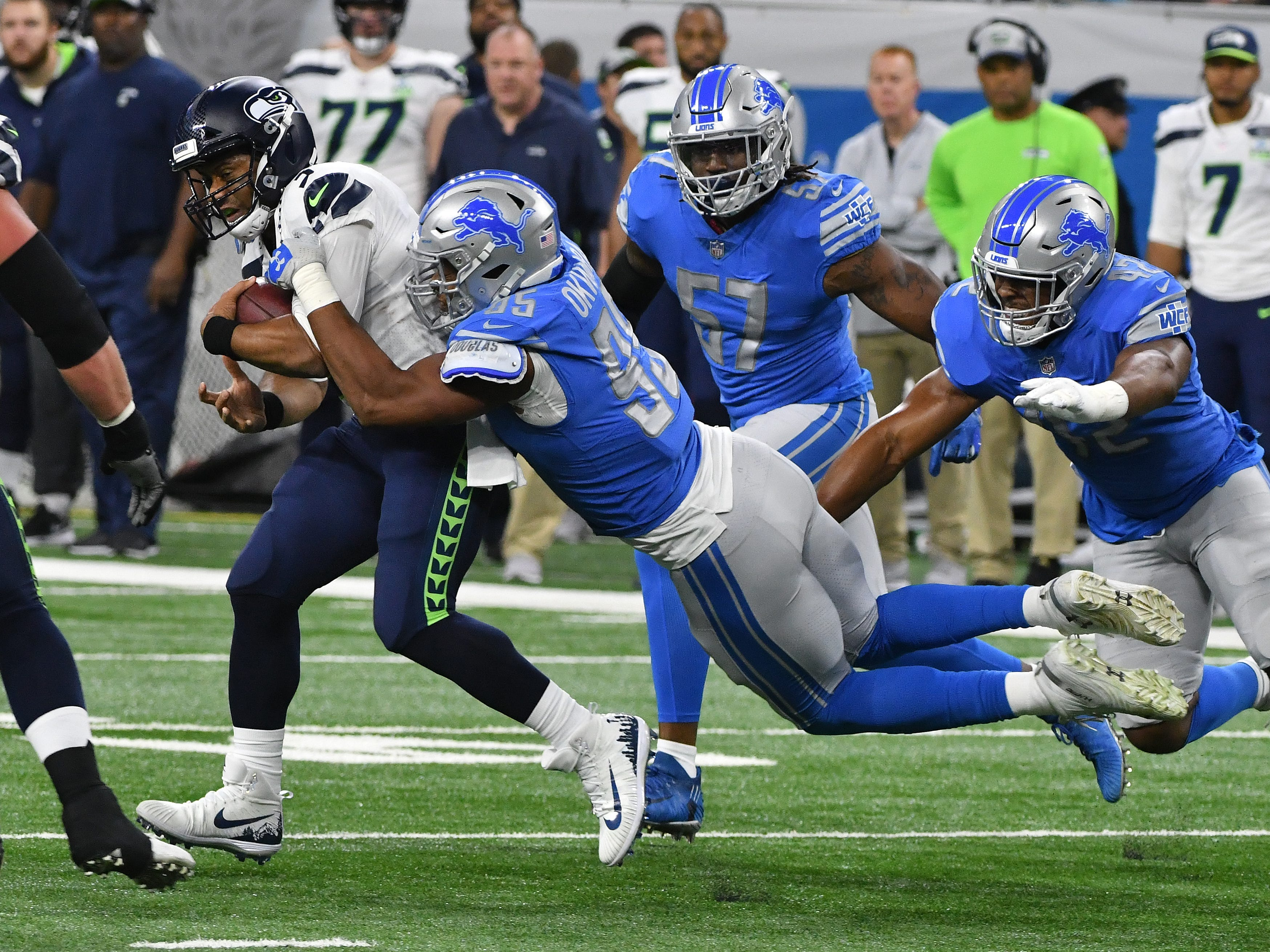 Seahawks quarterback Russell Wilson gets sacked by Lions' Romeo Okwara in the first quarter.