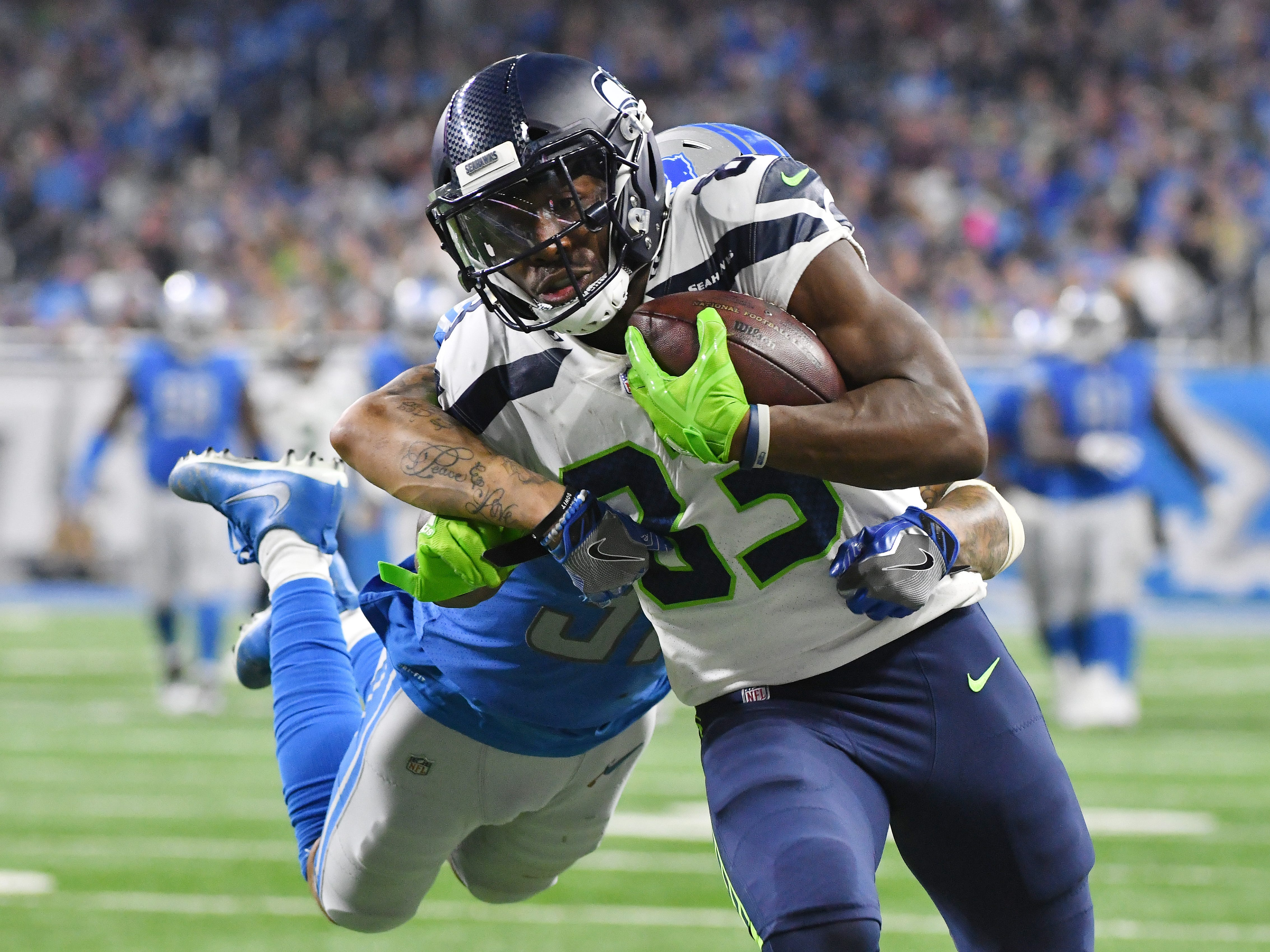 Seattles' wide receiver David Moore catches a long first down pass from quarterback Russell Wilson in front of Lions' Tees Tabor in the fourth quarter.