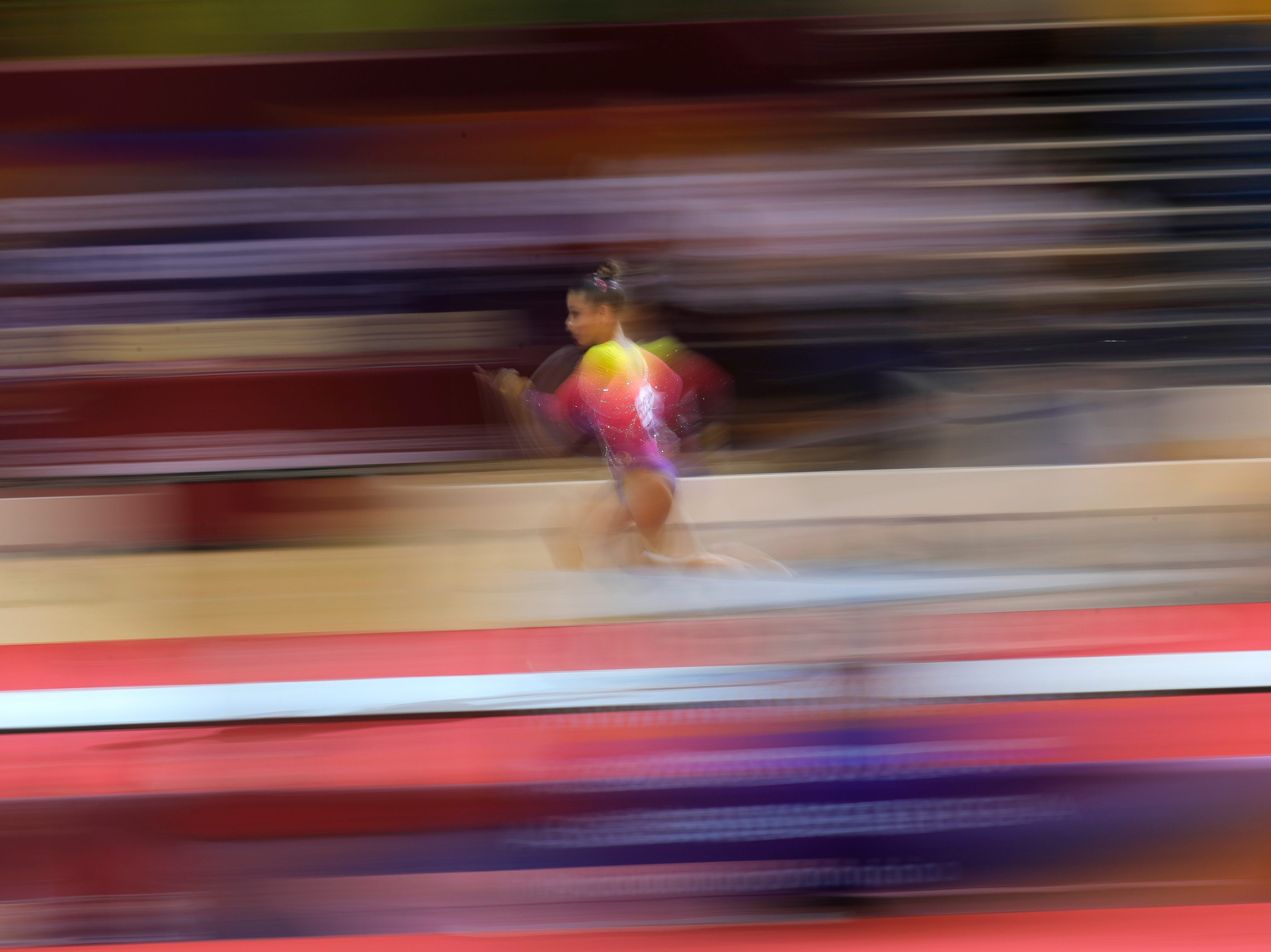 Brazil's Flavia Saraiva picks up speed as she runs toward the vault during qualifying sessions for the Gymnastics World Chamionships at the Aspire Dome in Doha, Qatar, Sunday, Oct. 28, 2018.