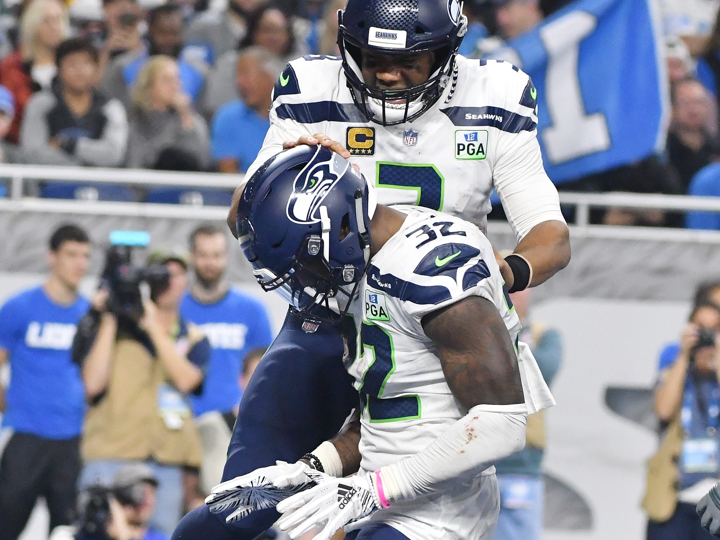 Seattle quarterback Russell Wilson celebrates with running back Chris Carson after his touchdown in the fourth quarter.