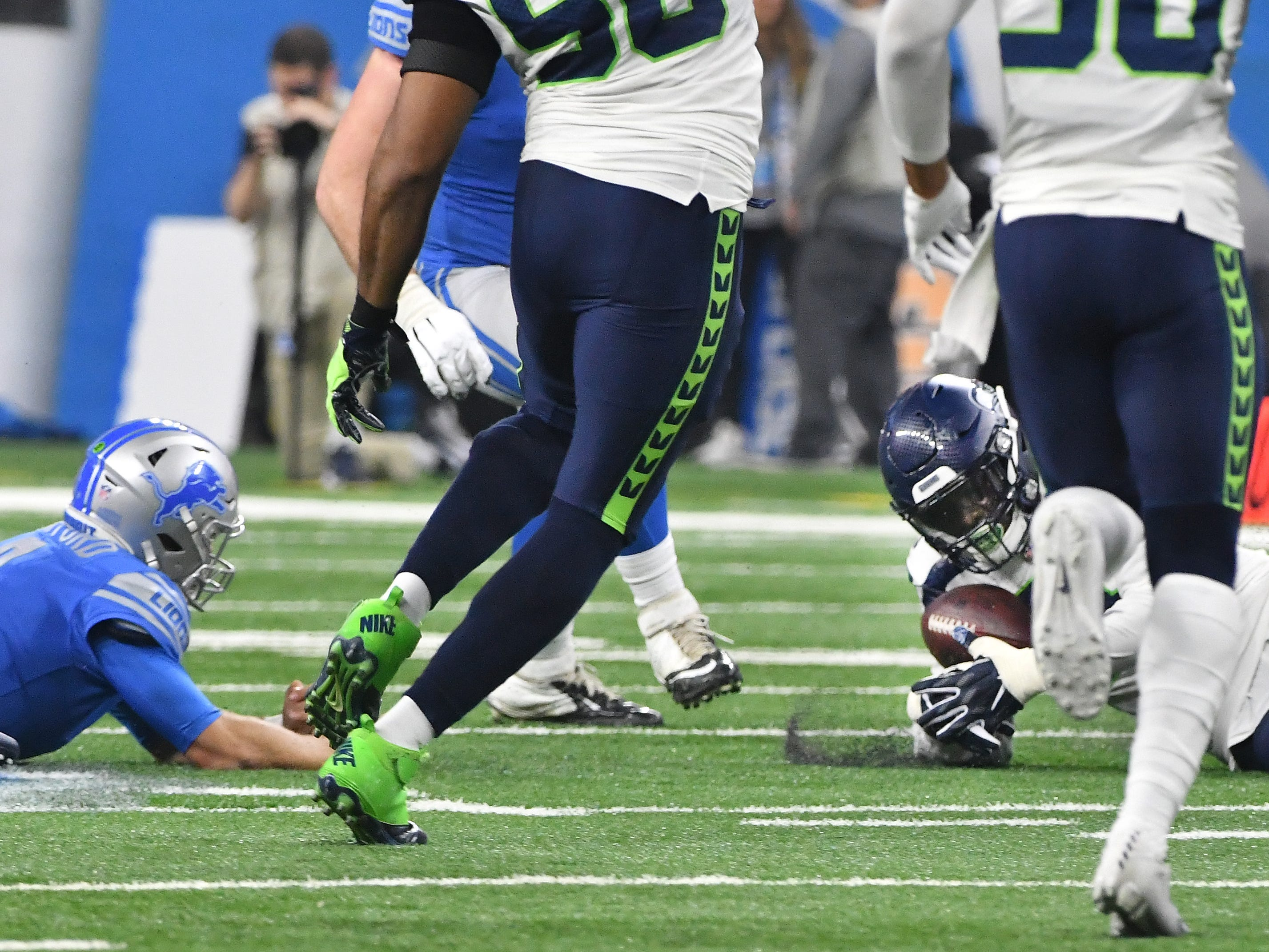 Lions quarterback Matthew Stafford fumbles the ball with Seattles' Frank Clark recovering in the fourth quarter.