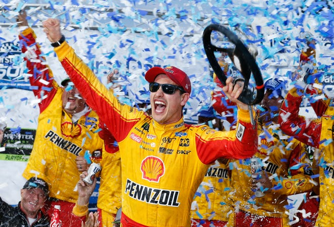 Joey Logano celebrates after winning Sunday's NASCAR Cup Series race at Martinsville Speedway.