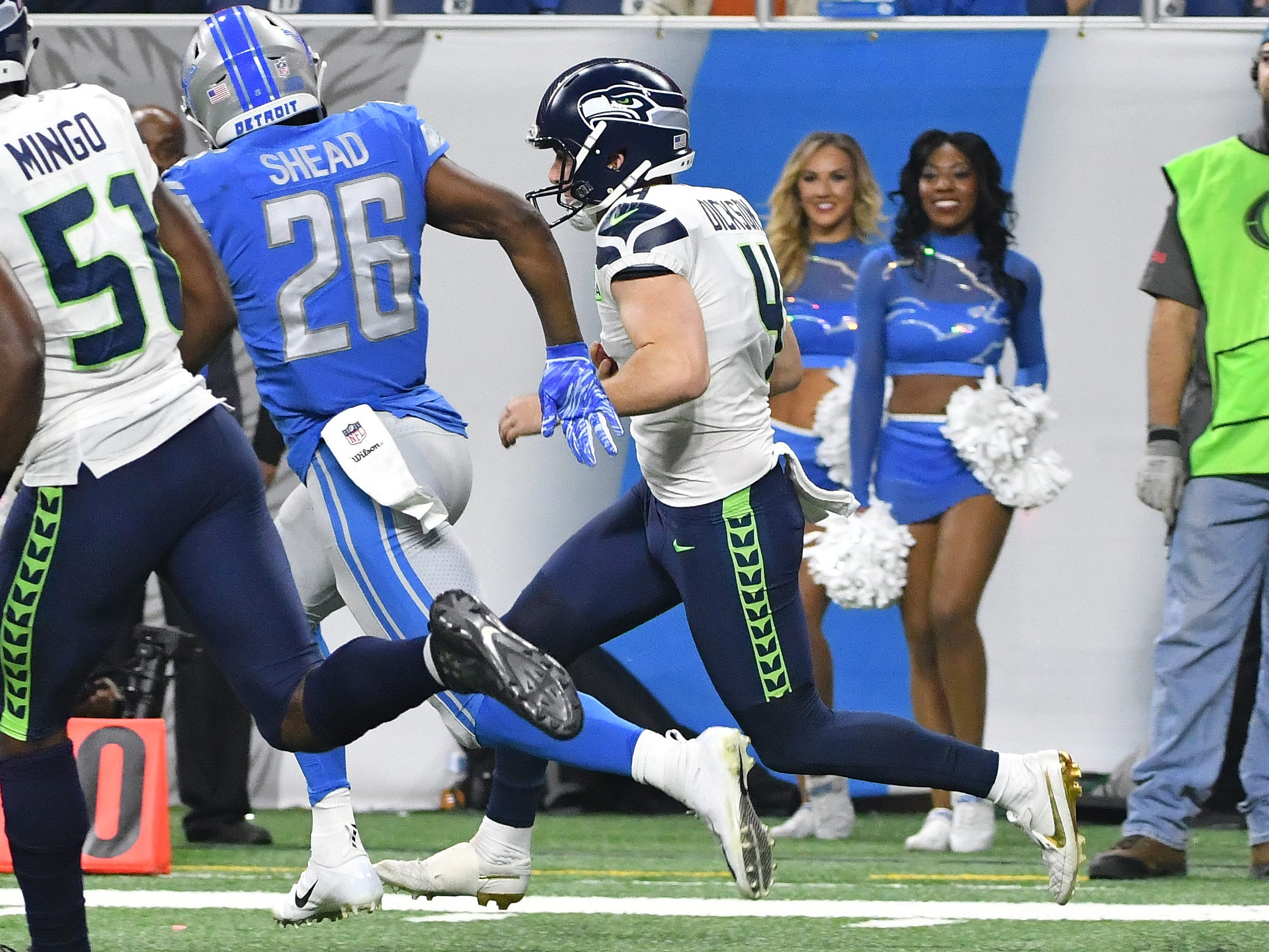Seahawks punter Michael Dickson fakes the kick from the end zone and instead, runs the ball out, picking up a first down and allowing Seattle to burn time on the clock with a new set of downs late in the fourth quarter.