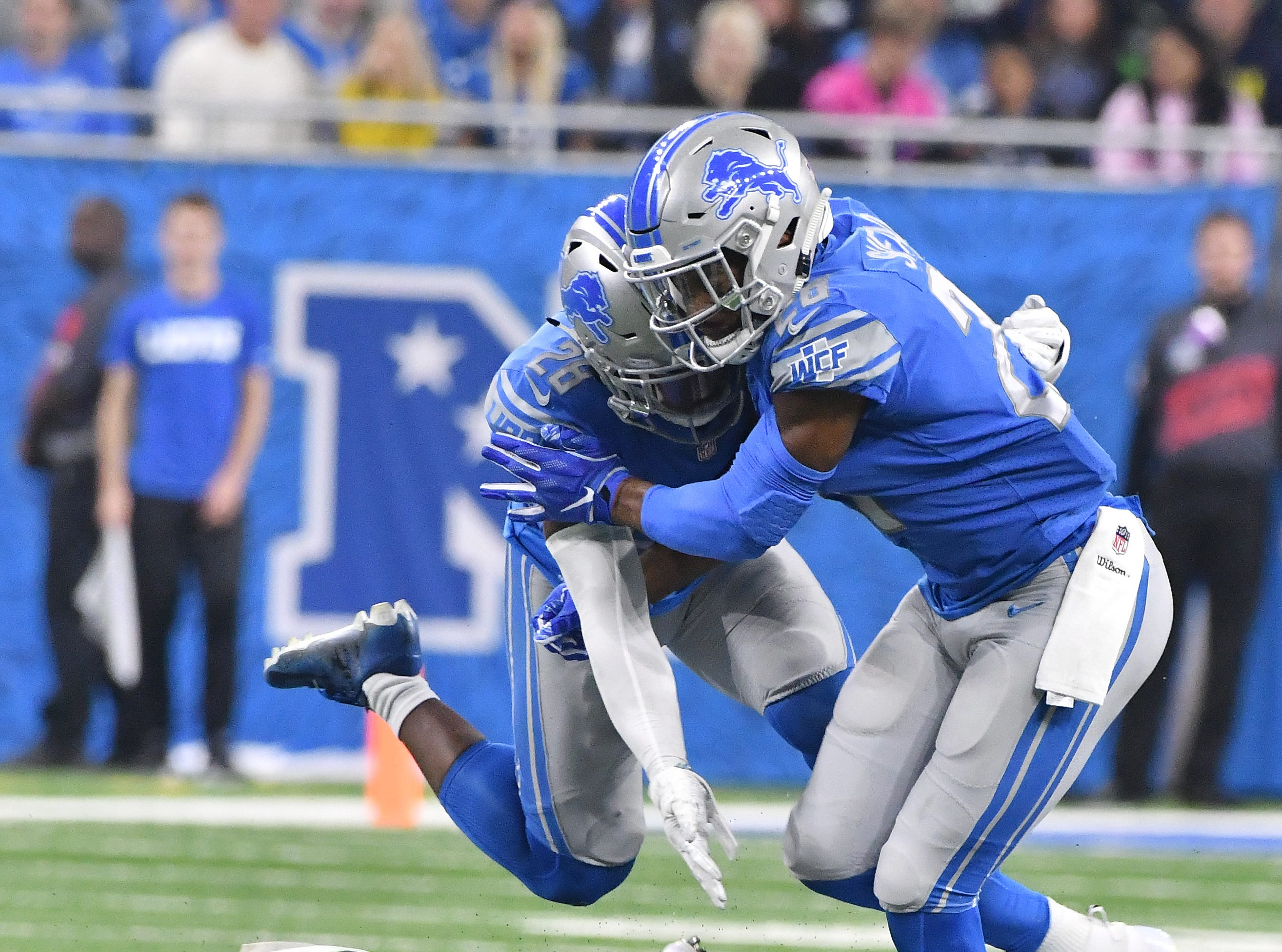 Lions' Quandre Diggs and Nevin Lawson collide into each other on a play that Seattles Nick Vannett did not make a reception but due to a facemark penalty by Detroit, picked up the first down anyways in the fourth quarter.