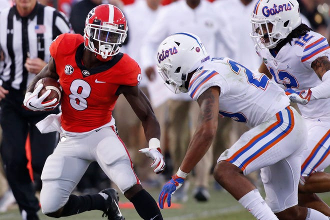 Georgia wide receiver Riley Ridley (8) moves the ball against Florida during the second half.