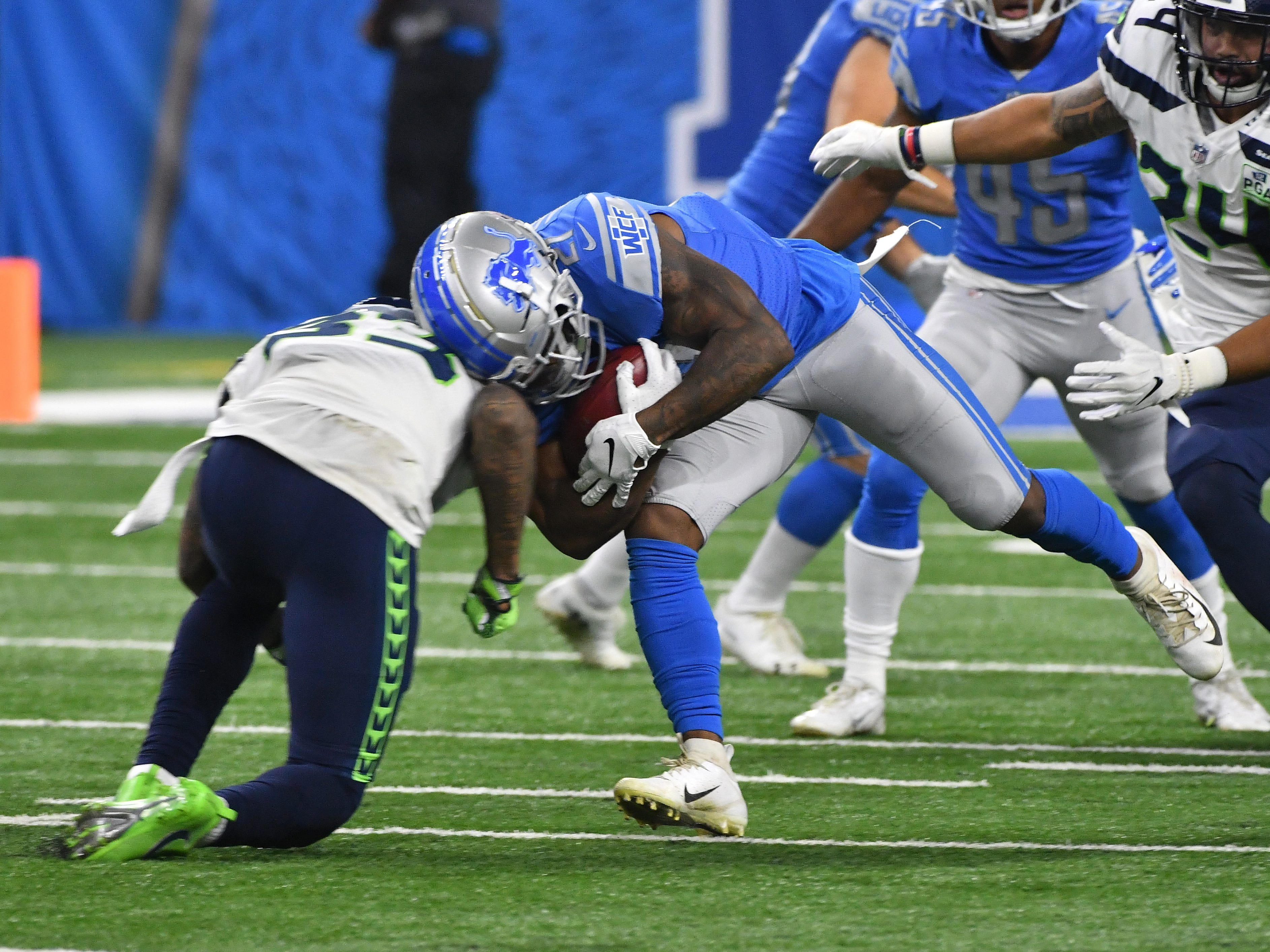 After a Seattle touchdown, Lions' Ameer Abdullah fumbles the ball on a kickoff return, during a hit by Seahawks' Cedric Thompson, which Seattle recovered in the second quarter.