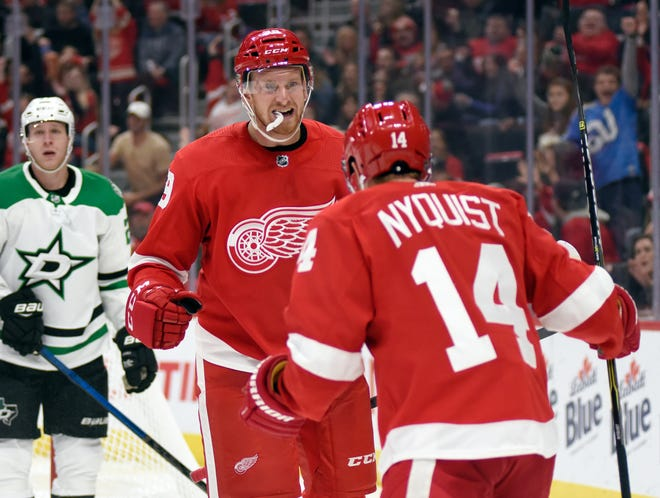 Detroit Red Wings right wing Anthony Mantha, front left, is congratulated by right wing Gustav Nyquist after scoring a goal against the Dallas Stars in the second period on Sunday.
