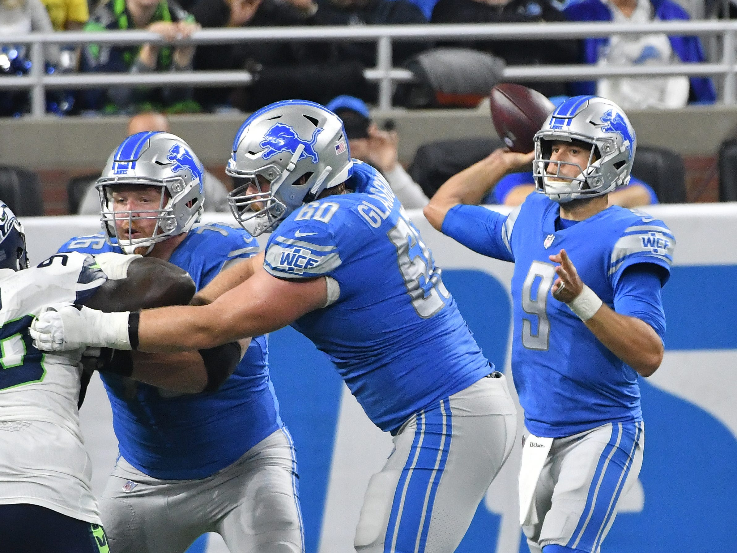 Lions quarterback Matthew Stafford throws with offensive linemen T.J. Lang and Graham Glasgow blocking in the fourth quarter.