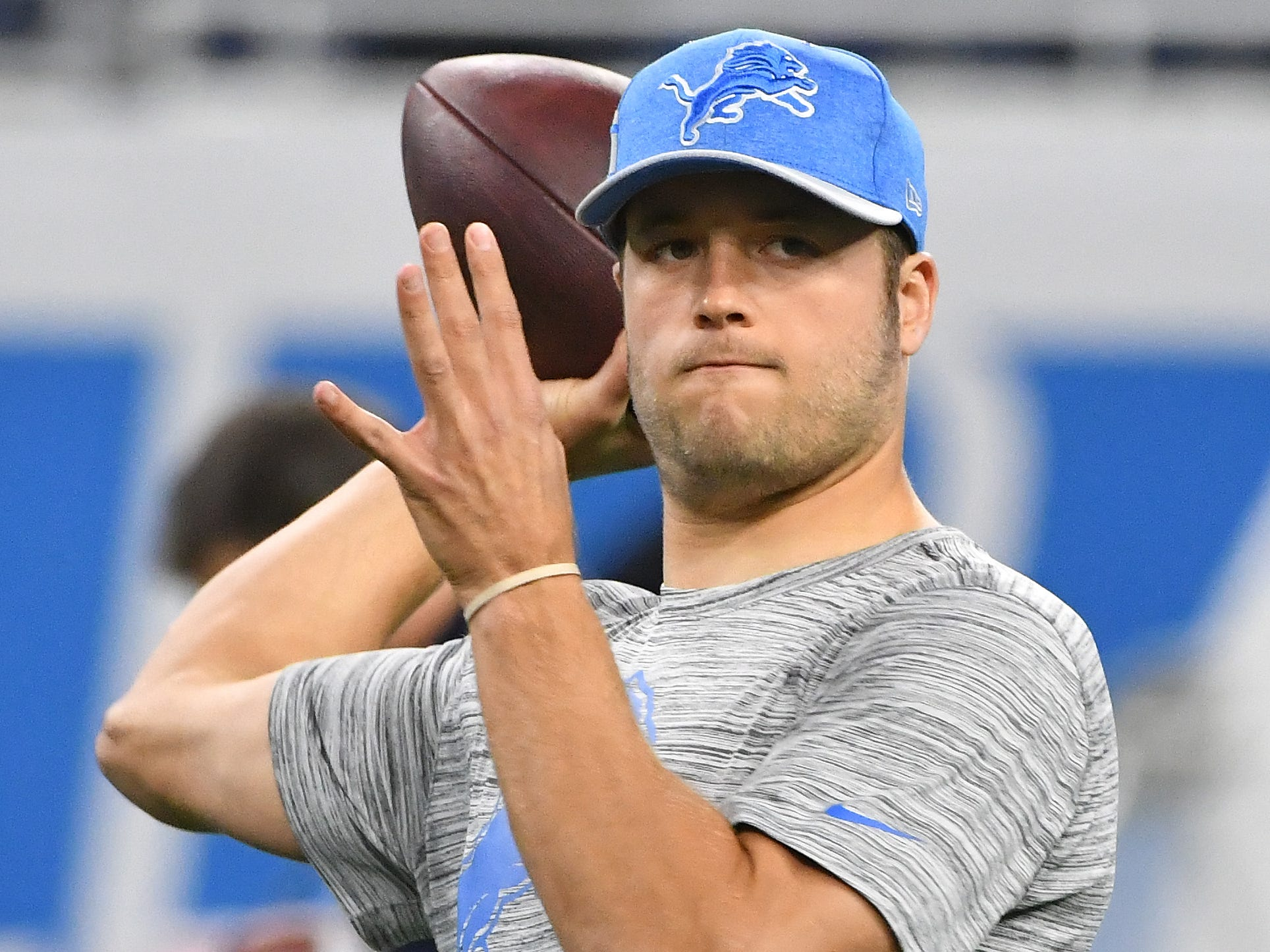 Lions quarterback Matthew Stafford warms up before the game.
