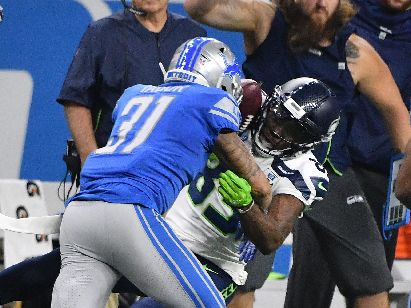 Seahawks' David Moore hangs onto a long reception down the sideline, that was reviewed, with Lions' Tees Tabor defending in the second quarter.