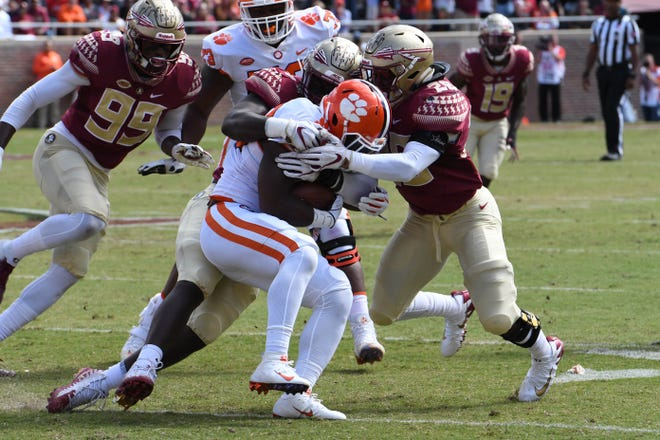 FSU redshirt freshman linebacker DeCalon Brooks (28) stopping the Clemson running back in the second quarter of FSU's game against Clemson on October 27th at Doak Campbell stadium.